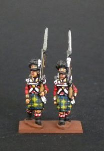 NB21- Highlanders flank company marching With Kilt